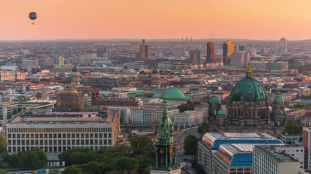 pitka : BERLIN, GERMANY - MAY,2019: Timelapse view of Berlin city centre from above, famous historical buildings at sunset.