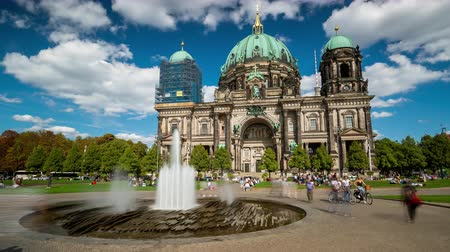pitka : BERLIN, GERMANY - MAY,2019: Timelapse view of the historic building Berlin Cathedral with funtain near the Spree River