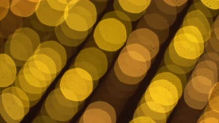 anos : Bokeh of blurred New Years flickering garlands. Beautiful Christmas background of warm golden lights. 4K Ultra HD