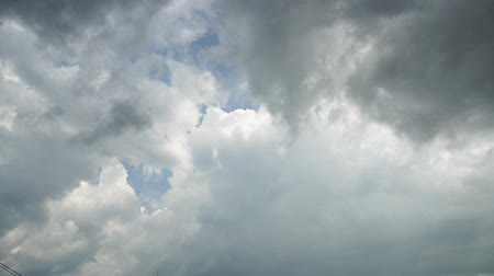 sztratoszféra : Rain is visible between thunderclouds. Storm clouds and light in sky. 4K video