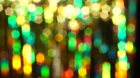 Magic abstract shiny background with colored defocused bokeh. Beautiful dynamic background in shining lights and sparkling particles. Festive mood. Christmas or holiday theme