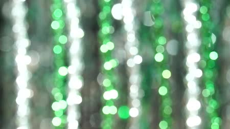мишура : Magic abstract shiny background with silver and green defocused bokeh. Beautiful dynamic background in shining lights and sparkling particles. Festive mood. Christmas or holiday theme