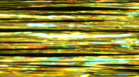 Abstract horizontal shiny background from golden tinsel. Beautiful dynamic background in shining lights and sparkling particles. Festive mood. Christmas or holiday theme Stock mozgókép