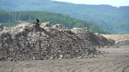 Heaps of ash and slag waste at ash and slag dump of thermal power. Problem of environmental pollution. Climate change from burning of hydrocarbon fuels