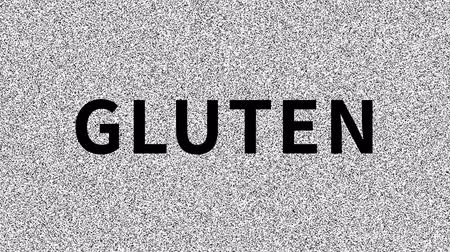 Gluten Harmful food. Word about food problem on noisy screen. Looping VHS interference. Stock mozgókép