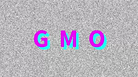 GMO. Word about food problem on noisy old screen. Looping VHS interference. Stock mozgókép