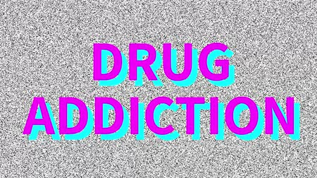 Drug Addiction. Word about medicine problem on noisy screen. Loop VHS interference.