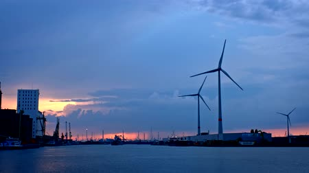 coulds : Wind turbines in Antwerp port on sunset.