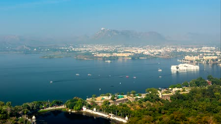 camera panning : Aerial view of Lake Pichola with Lake Palace (Jag Niwas) and Jag Mandir (Lake Garden Palace). Udaipur, Rajasthan, India Stock Footage