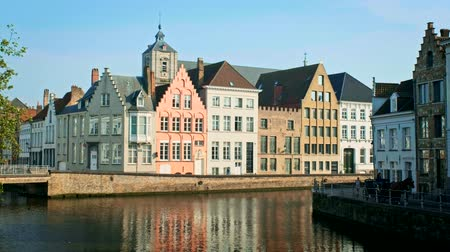 Old houses and canal in famoust tourist town of Bruges (Brugge), Belgium Stock Footage