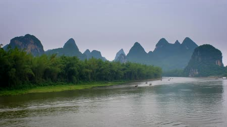guangxi : Tourist boats sailing o the Li River In Yangshuo, Guangxi