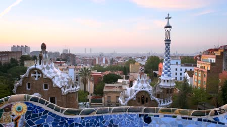 каталонский : Barcelona city view from Guell Park. Sunrise view of colorful mosaic building in Park Guell.