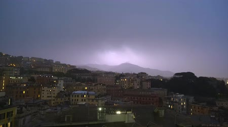 camera panning : Evening view of Genoa port with thunderstorm, Italy Stock Footage