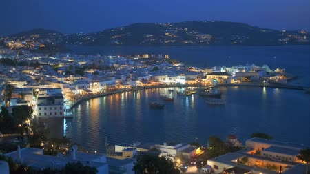 Эгейский : Mykonos island port with boats in the night, Cyclades islands, Greece Стоковые видеозаписи