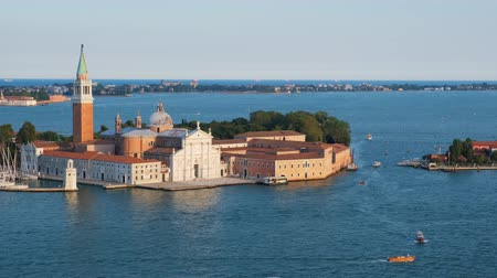 camera panning : Aerial view of Venice lagoon with boats and San Giorgio di Maggiore church. Venice, Italy