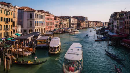 Timelapse of Grand Canal with boats and gondolas on sunset, Venice, Italy