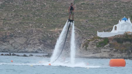 Man flying on a Flyboard Стоковые видеозаписи
