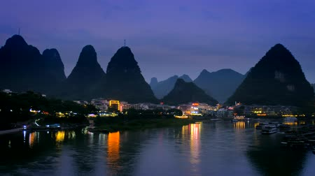 guangxi : Yangshuo town illuminated in the evening, China