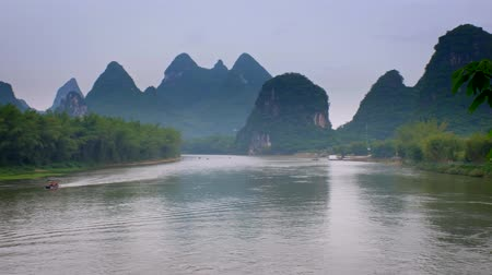 guangxi : Tourist boats on Li river with carst mountains in the background