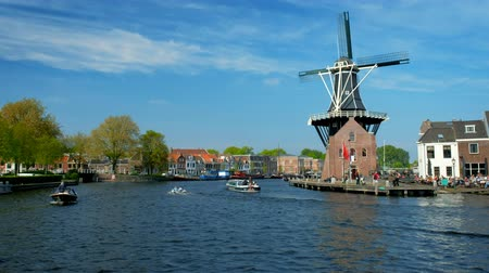 Harlem landmark windmill De Adriaan and boat on Spaarne river. Stock Footage