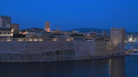 регата : Marseille Old Port and Fort Saint-Jean in night. Marseille, France