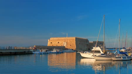 Venetian Fort in Heraklion and mooring fishing boats, Crete Island, Greece