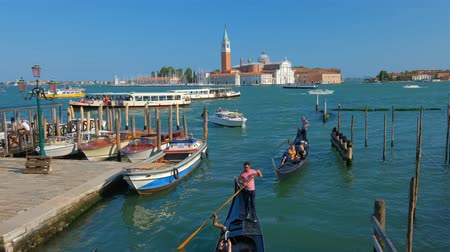 Gondolas in lagoon of Venice by Saint Mark (San Marco) square