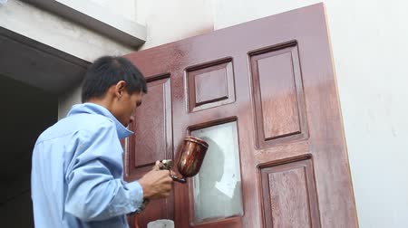ar : HAI DUONG, VIETNAM, JULY, 10: painter paint wooden door on july 10, 2013 in Hai Duong, Vietnam. Stock Footage