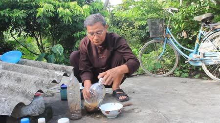 herbalist : HAI DUONG, VIETNAM, AUGUST, 26 2014: the medicine man and medicinal herbs