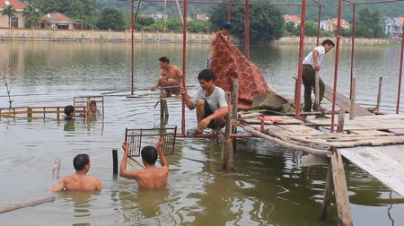 water puppet : HAI DUONG, VIETNAM, SEPTEMBER, 8: Artisans make water puppet show stage for water on September, 8, 2014 in Hai Duong, Vietnam Stock Footage