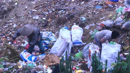 indigence : Haiduong, Vietnam, April, 13, 2015: Garbage trashes assorting gatherers in slums