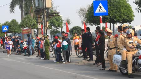 tremulous : Haiduong, Vietnam, December, 21, 2014: Athletes runtime in footrace