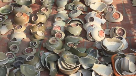 louça de barro : Haiduong, Vietnam, January, 27, 2015: archaeologists in excavation and ceramics, Chudau Stock Footage
