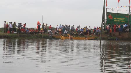 tradicional : Haiduong, Vietnam, February, 25, 2015: People on lake boat race at the traditional festival traditional, Vietnam