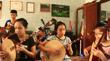 flet : Haiduong, Vietnam, june 6, 2015: Asian children playing traditional instruments