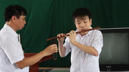 flutist : Boy playing the flute blind on May 31, 2013 in Asia Stock Footage