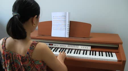 lesson : The girl playing piano Stock Footage