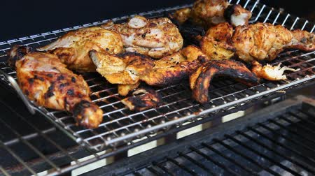 göğüs : Grilled Tandoori Chicken marinated with yogurt, garlic , ginger, and exotic spices cooking on a barbecue grill.