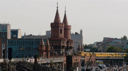 oberbaum : BERLIN - JULY 22: Real time lockdown wide shot of traffic at Oberbaum Bridge, July 22, 2016 in Berlin, Germany. Departure of the train from Warschauer str.