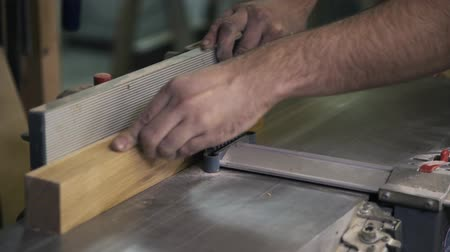 paneling : A craftsman is working with wood using a special industrial tool. Sanding a wooden bar. Real time close up shot. Stock Footage