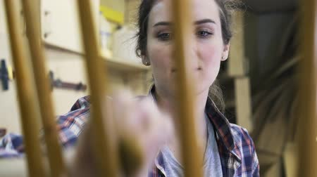 restorer : An inspired attractive carpenter is restoring the wooden chair. A concept of furniture workshop. Real time medium locked down shot. Stock Footage