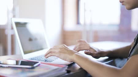 web sites : Close up of young woman s hands using laptop touchpad in an office. Locked down real time close up shot Stock Footage