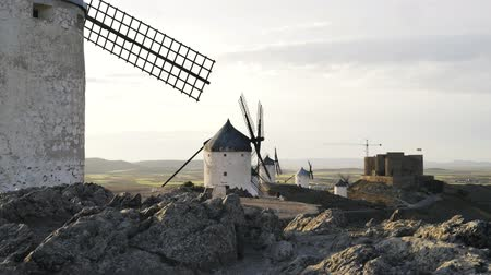 оборонительный : Windmills and a castle, Consuegra, Toledo province, Castilla la Mancha, Spain. Locked down time medium shot Стоковые видеозаписи