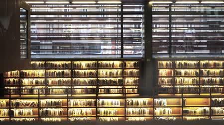 palacio real : Biblioteca Museo Nacional Centro de Arte Reina Sofia. Glowing bookshelves. Locked down real time medium shot Stock Footage