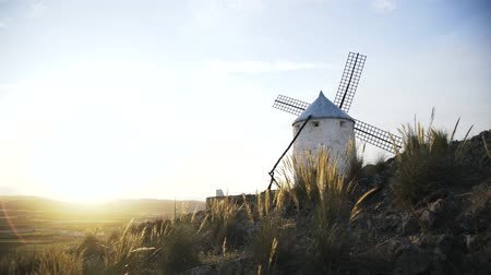 medeniyet : Close up of a windmill in Consuegra, Toledo, Spain. Sunny summer day, A wind. Side view. Locked down real time close up shot