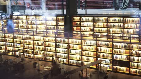palacio real : Biblioteca Museo Nacional Centro de Arte Reina Sofia. Glowing bookshelves. Tilt up real time medium shot