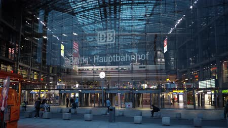 handheld shot : BERLIN - AUGUST 21: Real time establishing shot of a white arriving train at Berlin Central Station, August 21, 2017 in Berlin, Germany. Hauptbahnhof is the main railway station in the city.