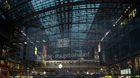 bahnhof : BERLIN - AUGUST 21: Real time tilt down shot of the Berlin Central Station at night, August 21, 2017 in Berlin, Germany. Hauptbahnhof is the main railway station in the city.