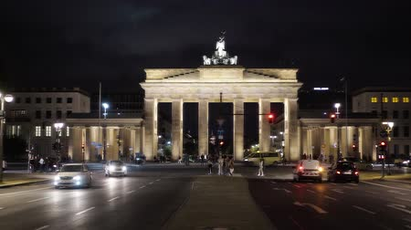 triumphal arch : BERLIN - AUGUST 21: Real time establishing left to right pan shot of The Brandenburg Gate, August, 21, 2017 in Potsdam, Germany. It is a famous tourist place with busy people traffic. Night time