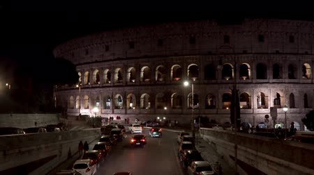 gladiatorial : ROME - FEB 20: Roman Colosseum Coliseum Flavian Amphitheatre Anfiteatro Flavio Colosseo, an oval amphitheatre in the center of Rome, Italy. Night time. Locked down real time medium shot Stock Footage